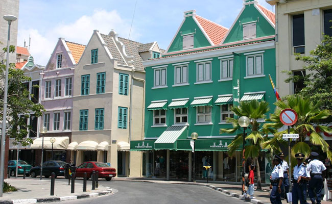 ... Caribbean accents such as verandas, porches, fretwork, and shutters  were added. The color scheme was updated as well, introducing a bright,  bold palette ...